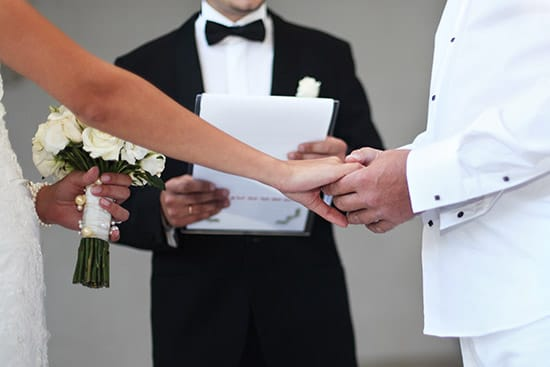 Ordained minister performing wedding ceremony